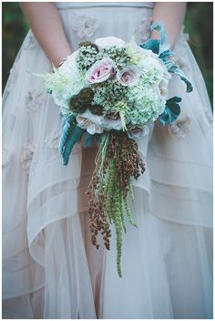 Garden inspired bouquet with cascading greenery - Florals by @studiobloommd Photography by Kristin Zabos