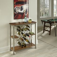 Inspired by 18th century French Creole cottages, the slotted shelves and metal casted legs are reminiscent of French Quarter architecture. The Orleans Wine Rack by Home Styles is the perfect additon to any home décor.