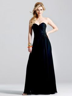 I love the contrast of the sleek black dress and the messiness of the hair