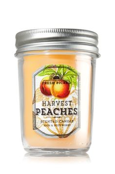 """Harvest Peaches - Mason Jar Candle - Bath & Body Works - Made with the highest concentration of fragrance oil, an exclusive blend of vegetable wax and lead-free wicks, our candles burn evenly for an amazing fragrance experience in a decorative Mason Jar! Candle burns approximately 30 to 40 hours and measures 2 3/4"""" wide x 4"""" tall."""
