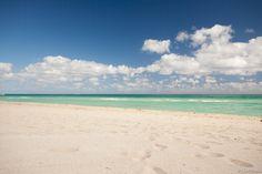 White sand - blue sky - green sea On Haulover Beach, Miami, Florida