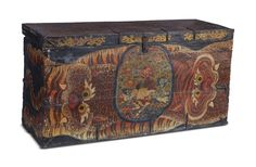 #Tibetan monastic boxes were used in the store rooms of monasteries to hold the brocades,ornaments, and other precious objects that were not used every day. These chests were often offered to the monastery by a sponsor, or were also commissioned by the monastic authorities themselves.A plain wide red border frames the field, painted to resembled a stretched tiger skin, symbolising the animal spirit's protection of the chest and its contents.