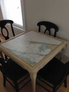 Vintage nautical charts as a table top for table that holds the