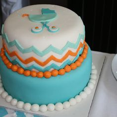 orange and turquoise chevron baby cake.
