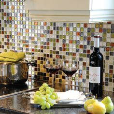 These are Smart Tiles. Avail at Home Depot or online. They stick over existing tiles and come in several colors that would work with your kitchen.