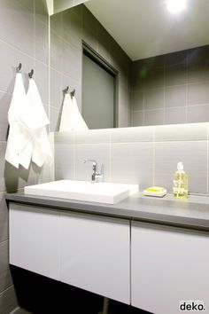 Hooks instead of towel bar. Much neater especially when someone doesn't want to hang up the towel nicely.