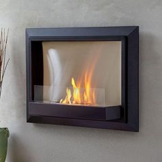 This stunning wall-hung ventless gel fireplace provides a clean, crackling flame.