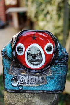 """My dog sighs..""""Street artist My Dog Sighs creates gorgeously painted faces on found crushed cans, which he then leaves on the streets in random places for passers-by to take home. It is both a street art installation project and an altruistic gesture dedicated to the cause of free art for everyone via: junk-culture.com"""""""