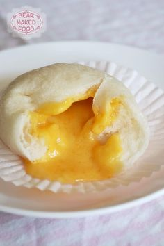 """There is something really satisfying about making (and eating) your own buns, especially these molten lava buns. The """"molten lava"""" is none other than the ever popular salted egg yolk custard filling. I had a fun time making the step-by-step video below, especially the part where I get to pry open the buns to reveal the filling inside. Also, I made a new friend that day called Calories..."""
