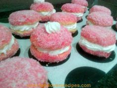 SNOWBALLS DIPPED IN RASPBERRY JELLY AND COCONUT