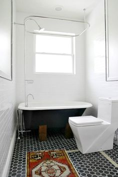 A bathtub in a bathroom. It's a novel idea. And we finally executed it in the main bathroom!...