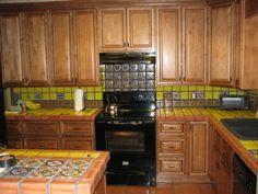 detail, glazed mexican tile backsplash, in hacienda style kitchen