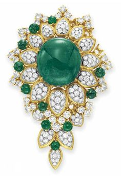 AN EMERALD AND DIAMOND BROOCH, BY VAN CLEEF & ARPELS   Set with an oval cabochon emerald, within a circular-cut diamond and cabochon emerald foliate surround, mounted in gold, with pendant hook for suspension, several stones deficient  Signed Van Cleef & Arpels, N.Y., no. 40705