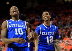 Kentucky Wildcats guard Archie Goodwin (10) and Kentucky Wildcats guard Ryan Harrow (12) laughed during an official's timeout