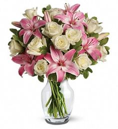 Pink asiatic lilies, white roses, and greens.