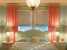 Great effect by hanging curtains up high.  good idea for curtains when have double windows and bed placed in front.