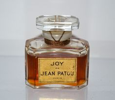 Jean Patou Joy Perfume : my dad bought this for my mom when he was in college. He could only afford not quite an ounce at the time. Its expensive! My mom told me after he graduated from college and started working he was able to get her a good bottle of it. It smells like jasmine and roses:)