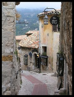 Eze (not far from Nice, Eze is a medieval village perched on a narrow rocky peak overlooking the Mediterranean sea. The ancient fortified village is still crowned with the ruins of its fortified castle (torn down in sitting on a narrow Eze France, Provence France, South Of France, Places In Europe, Places To Travel, Places To Visit, Nice Cote D Azur, Villas, Medieval