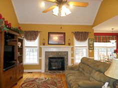 Family Room, Oak Hardwoods, Gas Log Fireplace, Vaulted Ceiling.  404 Morgan Trace Ln, Goldsboro, NC  Presented by Jeri Lynn Coker, Realtor  goldsbororealestatefinder.com