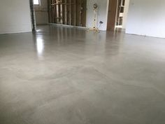 Even if concrete has been permanently stained, cover over it with a floor overlay. Very cost effective, and provides a fresh, and natural look to your home.