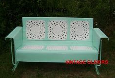 A gorgeous restored vintage metal glider. This reminds me of my grandma's front porch :)