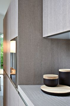 Fly by Elmar Cucine. Love the grey oak texture and delicate color of this detail.Elle
