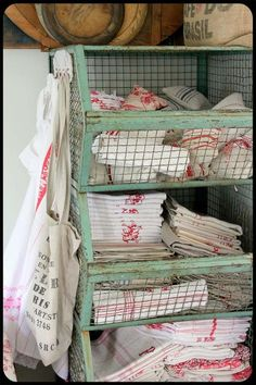 linens in vintage shabby racks .. how cool!