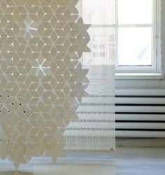 Swedish designer Mia Cullin's Flake is sold as a set of 160 star-shaped TYVEK pieces that can be assembled into an ethereal textured curtain, room divider or decorative element for the table or a wall...