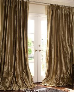 Silk Drapes.. I have a slighty darker brown in my bedroom. I luv the Puddled Drape look... E*