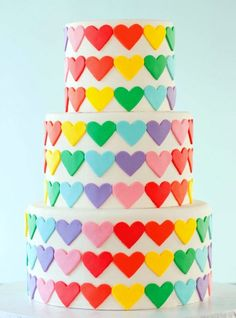 Rainbow hearts cake - Maybe just one tier & a rainbow cake underneath - so when you cut into it, it's pretty too?