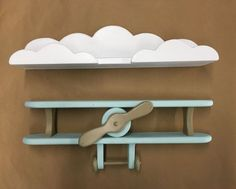 Baby Blue and Brown Handcrafted Wooden Airplane and White Cloud Shelf Combo Adorable to hang in a nursery, childs room or playroom. Handcrafted by my family of solid pine wood. A lot of time and energy are spent making round smooth edges and constructing each and every shelf. We strive to do our best in everything and strive to make a product that we are proud to display in our own home. We can customize the shelf with any color/s you would prefer just send us a message. Approx. Airplane…