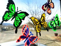 These pretty window clings are so easy to make!  All you need is puffy fabric paint and my free butterfly pattern.  They cling easily to your shiny clean window…