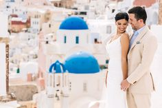Elizabeth & Chris' intimate wedding in Oia at Aspaki hotel by one of the best Santorini wedding photographers - Wedding at blue domes in Oia