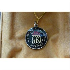 Beautiful enamelled Pendant made from a genuine 1942 silver sixpence on eBid United Kingdom