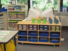 New Adventures in First Grade: Where it Happens Wednesday! SHARED classroom supplies and an interactive calendar time Classroom Supplies, Classroom Setup, Classroom Design, Classroom Organization, Classroom Management, Organization Ideas, Organizing, Kindergarten Lesson Plans, Kindergarten Reading