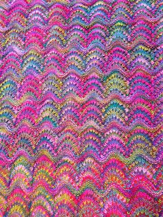... really good use of a simple lace pattern with a highly variegated yarn