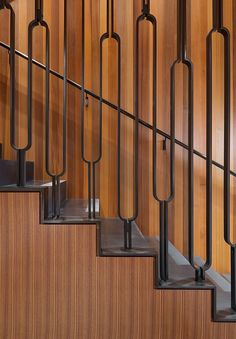 These wood and steel stairs have a decorative handrail that leads up to the front door and master bedroom. Staircase Handrail, Steel Handrail, Stair Railing Design, Metal Railings, Staircases, Steel Stairs Design, Banisters, Basement Stairs, House Stairs