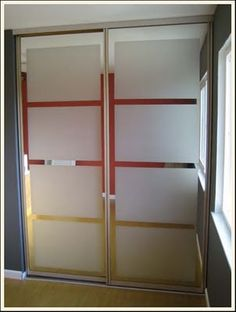 A great idea for updating mirrored closet doors.
