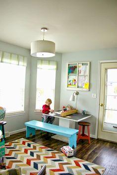 Furniture rearrangement, feels like a new home, kid art room, diy art table, kids playroom, kids home decor, chevron rug, big ceiling light, dark wood floors, room with gray walls, kids art display ideas, craft room, art room ideas