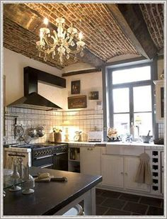 French kitchen with a wow stove and brick barrel vault ceiling detail with wood beams