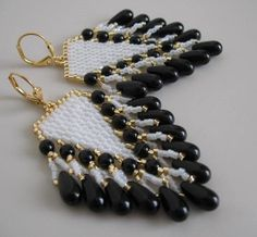 These pretty bead woven earrings are handmade with white luster, & golden seed beads. With Czech glass drops, & 4mm Czech glass round beads(druks).