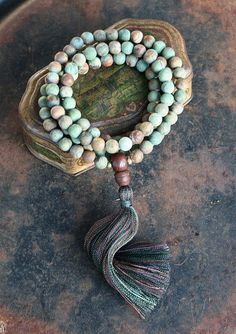Mala necklace made of 108, 10 mm - 0.394 inch, beautiful frosted opal gemstones. The guru is a bodhi seed bead - look4treasures on Etsy