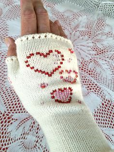 In we released our free Sweetheart Glovelets pattern. To celebrate our anniversary, we have reimagined the original pattern -- and it's still free! Beads create a whimsical heart design, and bring color, sparkle, and fun to your knitting. Mitten Gloves, Mittens, Knit Crochet, Crochet Hats, Fingerless Mitts, Wrist Warmers, Knitting Patterns Free, Knitted Hats, Handmade Items