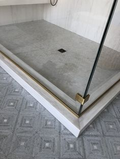 shower enclosure detail - geometric tile, cement and chrome look-a-like accents, brass metal Bath Design, Home Design, Floor Design, Bathroom Inspiration, Interior Inspiration, Bathroom Ideas, Bathroom Stall, Rental Bathroom, Washroom