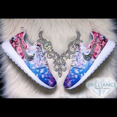 Swarovski Premium Nike Roshe One Cherry Blossom Authentic Women's Nike Roshe Cherry Blossom athletic shoes.  Outer swooshes are encrusted with hundreds of real Swarovski® crystals in all different sizes to ensure maximum brilliance and shine.  Brand new in original box, purchased directly from an authorized Nike retailer.  Crystals have been applied with industrial strength glue. Will never come off.  Please allow up to 2 weeks to receive your order.  For better pricing and more styles…