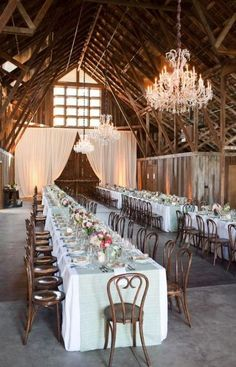 This rustic California barn venue is spectacular, with dramatic large doors. You can either dress it up or leave it rustic—it works for all styles. wedding chandelier A Barn Wedding Amongst The Towering California Redwoods! Wedding Reception Layout, Reception Ideas, Wedding Seating, Reception Table, Redwood Forest Wedding, Perfect Wedding, Dream Wedding, Luxury Wedding, Barn Parties