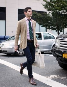 Pink shirt, green & blue tie, dark jeans, brown shoes, khaki blazer. #men #style #fashion