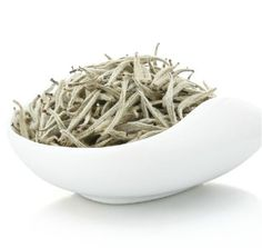 Silver Needle White Tea in London.  Silver Needle White Tea is considered as the most elegant, the most gentle, the most delicate white tea. Historically, it was the tea of Chinese elite, and not everybody could afford drinking it. To make this tea, only the upper buds covered with a delicate white nap are used. This tea is made solely of such buds, without leaves, which makes its flavor and aroma especially nice.