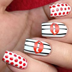 This one is actually much easier than you think. Just paint your nails white, then pick which finger would have the polka dots and the stripes. Then you can either find transfer stickers in the shape of your puckers or cut out from nail strips and glue in your nails with nail polish and your design is done.