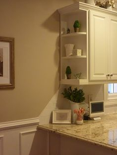 how to end the backsplash. i like the shelves on the sides of the cabinet.